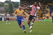 Luke Croll of Exeter City (23) clears the ball from Calum Butcher of Mansfield Town (16) during the EFL Sky Bet League 2 match between Mansfield Town and Exeter City at the One Call Stadium, Mansfield, England on 15 September 2018.
