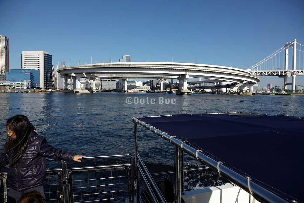 Rainbow bridge and the circled ramp road seen from the water Tokyo Japan