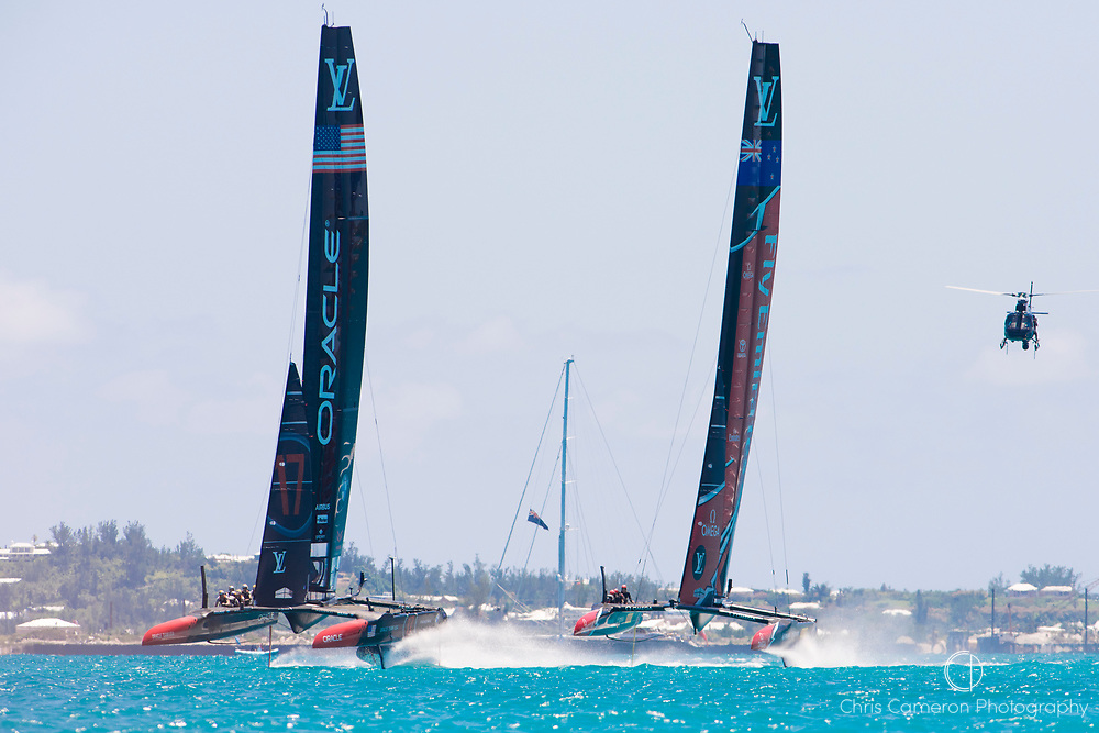 The Great Sound, Bermuda, 18th June. Oracle Team USA and Emirates Team New Zealand in pre start for race three on day two of the America's Cup.