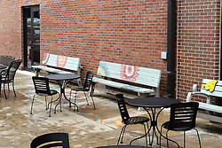 11 July 2015:  Benches and tables between buildings in Uptown Normal at the entrance to a small comfort courtyard area created by Harry and Barbie Fuller.  Shot at the  2015 Sugar Creek Arts Festival in Uptown Normal Illinois
