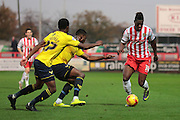 Stevenage FC forward Armand Gnanduillet, Oxford United midfielder AJ George and Oxford United defender Chey Dunkley during the Sky Bet League 2 match between Stevenage and Oxford United at the Lamex Stadium, Stevenage, England on 31 October 2015. Photo by Jemma Phillips.