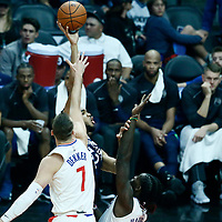 06 December 2017: Minnesota Timberwolves center Karl-Anthony Towns (32) goes for the baby hook over LA Clippers forward Sam Dekker (7) and LA Clippers forward Montrezl Harrell (5) during the Minnesota Timberwolves 113-107 victory over the LA Clippers, at the Staples Center, Los Angeles, California, USA.