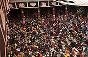 """A prayer ceremony is held in the Jokhang Temple (""""House of the Lord"""") in Lhasa is the holiest site in Tibetan Buddhism. It draws thousands of prostrating Tibetan pilgrims, as well as curious foreign tourists every year. <br /> <br /> The Jokhang Temple was founded in 647 by King Songtsen Gampo (r.617-49), the first ruler of a unified Tibet, and his two foreign wives who are credited with bringing Buddhism to Tibet. The king's first wife, Princess Bhrikuti,the sister of the Nepalese king, while his second wife, Princess Wencheng was the niece or daughter of the Chinese emperor."""