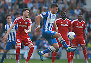 Brighton striker Tomer Hemed shields the ball from Cardiff City defender Scott Malone during the Sky Bet Championship match between Brighton and Hove Albion and Cardiff City at the American Express Community Stadium, Brighton and Hove, England on 3 October 2015. Photo by Bennett Dean.