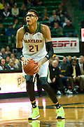 WACO, TX - JANUARY 28: Isaiah Austin #21 of the Baylor Bears shoots a three-pointer against the West Virginia Mountaineers on January 28, 2014 at the Ferrell Center in Waco, Texas.  (Photo by Cooper Neill/Getty Images) *** Local Caption *** Isaiah Austin