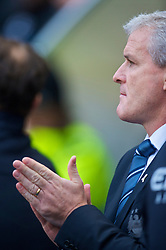 MANCHESTER, ENGLAND - Saturday, November 28, 2009: Praying for a victory... Manchester City's manager Mark Hughes before the Premiership match against Hull City at the City of Manchester Stadium. (Photo by David Rawcliffe/Propaganda)