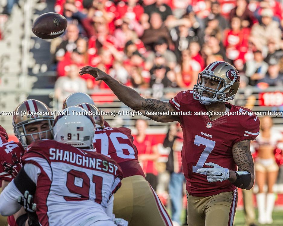 December 28, 2014: San Francisco 49ers quarterback Colin Kaepernick (7) passes ball over crowd on Sunday, December 28, 2014, at Levis Stadium in Santa Clara, California. The 49ers defeated the Cardinals 20-17.