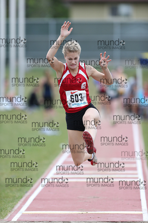 Tristen Stinkowji of Englehart HS - Englehart competes in the junior girls long jump at the 2013 OFSAA Track and Field Championship in Oshawa Ontario, Thursday,  June 6, 2013.<br /> Mundo Sport Images / Sean Burges