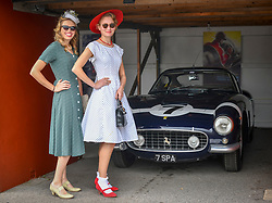 © Licensed to London News Pictures.09/09/2018. Goodwood. West Sussex, UK. <br /> The Goodwood motor circuit celebrates the 20th anniversary of the Revival.The Revival has become one of the biggest annual historic motorsport events in the world and the only one to be staged entirely in period dress. Each year over 150,000 people descend on this quiet corner of West Sussex to enjoy the three-day event. <br /> Pictured. Emily and Georgia Toulson-Clarke.<br /> Photo credit: Ian Whittaker/LNP