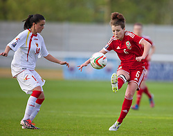 BANGOR, WALES - Thursday, May 8, 2014: Wales' Angharad James in action against Montenegro during the FIFA Women's World Cup Canada 2015 Qualifying Group 6 match at the Nantporth Stadium. (Pic by David Rawcliffe/Propaganda)