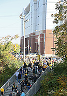September 29 2012: Fans walk up the stairs from the Hawkeye Express train to the stadium before the start of the NCAA football game between the Minnesota Golden Gophers and the Iowa Hawkeyes at Kinnick Stadium in Iowa City, Iowa on Saturday September 29, 2012. Iowa defeated Minnesota 31-13 to claim the Floyd of Rosedale Trophy.