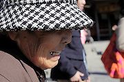 elderly Japanese woman during a temple visit