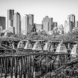 Boston skyline black and white picture with a ruined pier as part of old Port of Boston.