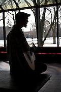 Chris Barbey '12 practices his acoustic guitar in the Forum South Lounge on Wednesday afternoon at Grinnell College. BEN BREWER/Grinnell College