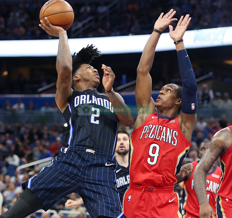 December 22, 2017 - Orlando, FL, USA - The Orlando Magic's Elfrid Payton (2) shoots past the New Orleans Pelicans' Rajon Rondo (9) at the Amway Center in Orlando, Fla., on Friday, Dec. 22, 2017. (Credit Image: © Stephen M. Dowell/TNS via ZUMA Wire)