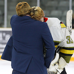 TRENTON, ON  - MAY 5,  2017: Canadian Junior Hockey League, Central Canadian Jr. &quot;A&quot; Championship. The Dudley Hewitt Cup Game 7 between Georgetown Raiders and the Powassan Voodoos.    Nate McDonald #33 and Powassan Voodoos Head Coach hug each other post game. <br /> (Photo by Alex D'Addese / OJHL Images)