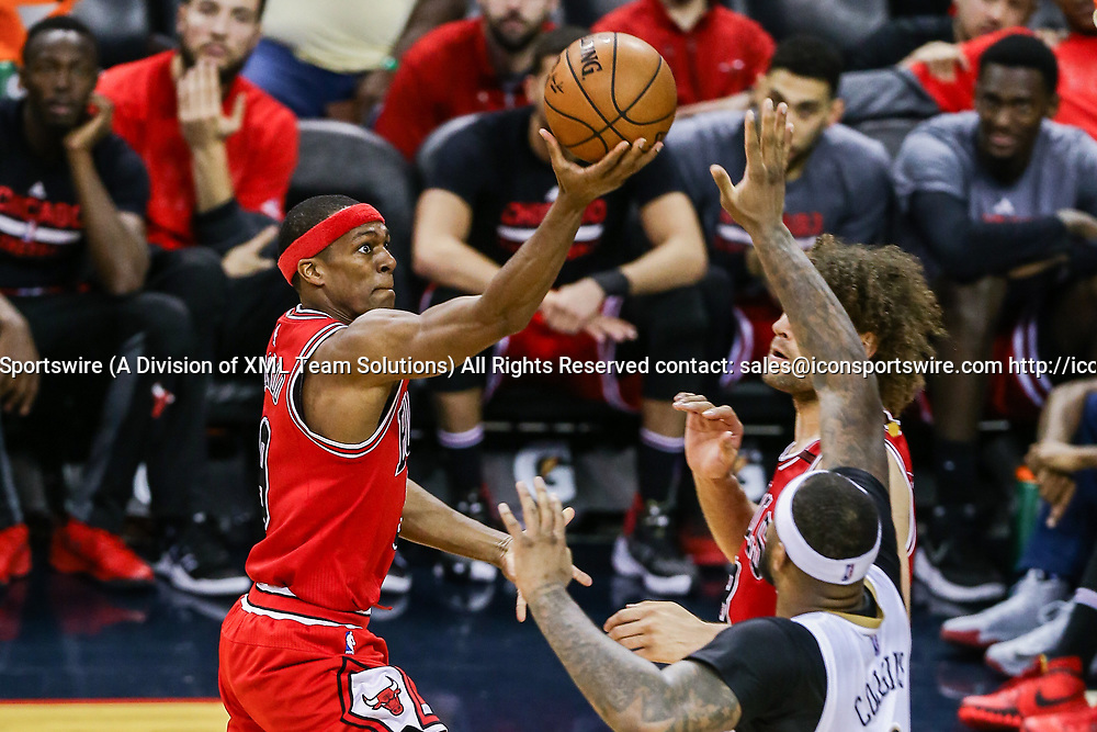 NEW ORLEANS, LA - APRIL 02: Chicago Bulls guard Rajon Rondo (9) drives to the basket against New Orleans Pelicans forward DeMarcus Cousins (0) during the game between the New Orleans Pelicans and the against the Chicago Bulls on April 2, 2017, at Smoothie King Center in New Orleans, LA.  Bull won 117-110. (Photo by Stephen Lew/Icon Sportswire)