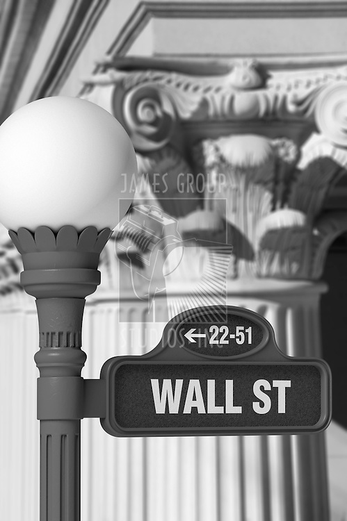 Black and white image of a Wall Street sign post in front of rows of Corinthian columns
