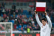 Poland's Robert Lewandowski with trophy before international friendly soccer match between Poland and Ireland at Inea Stadium in Poznan on November 19, 2013.<br /> Robert Lewandowski will play 60 match for the national team in his career.<br /> He will become a member of Outstanding Club Representative.<br /> <br /> Poland, Poznan, November 19, 2013<br /> <br /> Picture also available in RAW (NEF) or TIFF format on special request.<br /> <br /> For editorial use only. Any commercial or promotional use requires permission.<br /> <br /> Mandatory credit:<br /> Photo by &copy; Adam Nurkiewicz / Mediasport