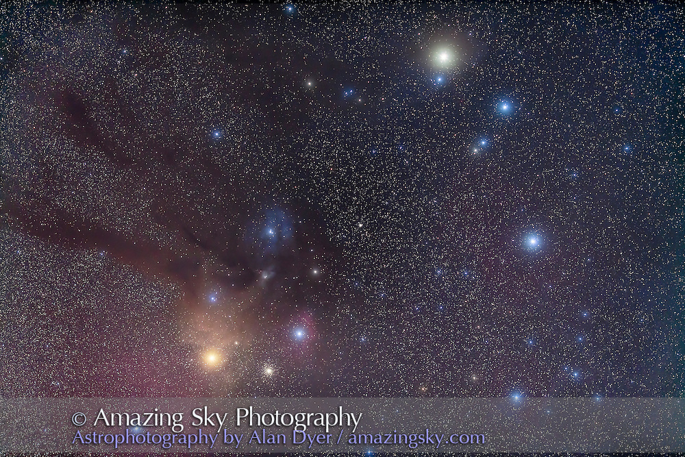 Saturn, at top right, off Beta Scorpii in the head of Scorpius, March 2015. Antares is the yellow star at lower left. The field is rich in colourful blue & yellow reflection and red & magentia emission nebulas. I shot this the morning of March 28, 2015 from Silver City, New Mexico, with the 135mm telephoto at f/2.2 for a stack of 4 x 1.5-minute exposures with the Canon 5D MkII at ISO 800, plus two additional exposures of the same length taken through the Kenko Softon A filter and layered in Photoshop to add the star glows.