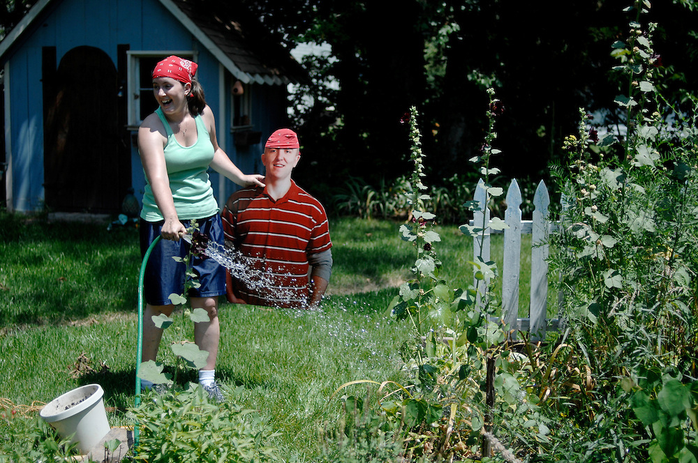 Amanda Stapp and her husband, Jason, are helping a friend plant a rose bush in the garden. The newlyweds smile in the midday sunshine, wearing matching do-rags.<br /> <br /> This is typically a &quot;husband duty,&quot; as Amanda calls it, but Jason quietly sits to the side as his wife clears the spot for the plant. She retrieves the tools from the garage, digs a hole, stakes the rose and waters the garden.<br /> <br /> When she accidentally sprays him with the hose, she picks him up, wipes him off and sets him down out of the way. Later, she takes a picture of him next to the bush so he'll know he was here.<br /> <br /> Jason, a captain in the Army National Guard, is serving a 400-day deployment in Kosovo. He left just two months after their wedding on Valentine's Day. His stand-in - a foam-core torso dubbed &quot;Flat Jason,&quot; created with the help of www.flatdaddies.com - is a companion for Amanda on the adventures they would normally have together.<br /> <br /> She writes a blog - www.ayeartogetherapart.blogspot.com - so he can see what they are up to back in Columbia. She takes him to the farmers market, church on Sunday, bowling with friends, even the recent Willie Nelson concert at Jesse Hall.<br /> <br /> Inevitably there are stares and questions. &quot;Carrying him around really opens up the communication lines,&quot; Amanda says. &quot;People will stop and talk, and they forget that we have military stationed all over the world, not just Iraq and Afghanistan.&quot;<br /> <br /> On Fridays, Amanda reaches for a red, white and blue paper chain hanging from her bedroom door. She rips off a link, knowing he is one week closer to being home. Only 42 more to go.