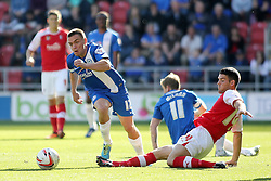 Peterborough United's Paul Taylor in action with Rotherham United's Mark Bradley - Photo mandatory by-line: Joe Dent/JMP - Tel: Mobile: 07966 386802 28/09/2013 - SPORT - FOOTBALL - New York Stadium - Rotherham - Rotherham United V Peterborough United - Sky Bet One