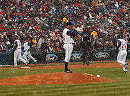 Cleveland pitcher Paul Byrd, center, looks back at umpire Rick Reed after he called for the first weather delay..Snow delayed the home opener of the Cleveland Indians/Seattle Mariners contest at Jacobs Field, April 6, 2007