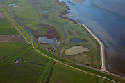 Nederland, Friesland, Gemeente Dongeradeel, 08-09-2009; Peazemerlannen, kweldergebied grenzend aan het Wierumerwad en de Waddenzeee. Het gebied is ontstaan door spontane uitpoldering bij storm in 1973 waarbij er een gat geslagen werd in de bitumendijk. Links de zeedijk (op delta hoogte) in het midden de zigzag lopende dijk van de zomerpolder. Het natuurgebied is in beheer bij  It Fryske Gea. .Peazemerlannen, salt marshes bordering the Wierumerwad and Waddenzeee. The area has been created in 1973, a severe storm made a hole in the outside polder dike. Left the seawall (delta height),  in the middle of the zigzag dike  of the summer polder. The area is a nature reserve, managed by It Fryske Gea.luchtfoto (toeslag); aerial photo (additional fee required); .foto Siebe Swart / photo Siebe Swart