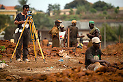 A Chinese foreman surveys the construction site of the Kipe hospital in Conakry, Guinea on Wednesday March 4, 2009. The Kipe hospital is a 10 million dollars project entirely funded by the Chinese government. (Olivier Asselin for the New York Times)