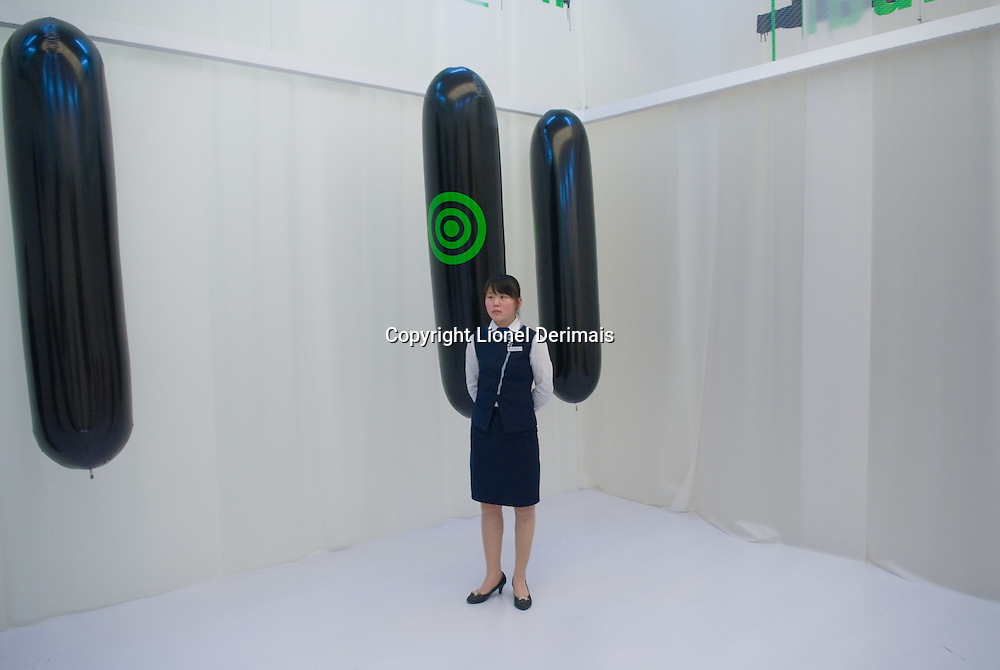 A guard at Beijing Namoc museum during Synthetic Times exhibition. The balloons are part of Yvonne Wilhelm and Christian Hubler's Naked Bandits creation from Knowbotic Research at their Naked Bandit creation. 06/2008