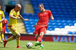 CARDIFF, WALES - Friday, June 5, 2015: Wales' Gareth Bale and David Cotterill during a practice match at the Cardiff City Stadium ahead of the UEFA Euro 2016 Qualifying Round Group B match against Belgium. (Pic by David Rawcliffe/Propaganda)