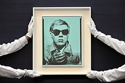 June 23, 2017 - London, UK - London, UK. Technicians show ''Self-Portrait'', 1963-64, by Andy Warhol (estimate GBP5-7m) at the preview of Sotheby's Contemporary Art Sale in New Bond Street.  The auction, which is dominated by Pop art, takes place on 28 June. (Credit Image: © Stephen Chung/London News Pictures via ZUMA Wire)
