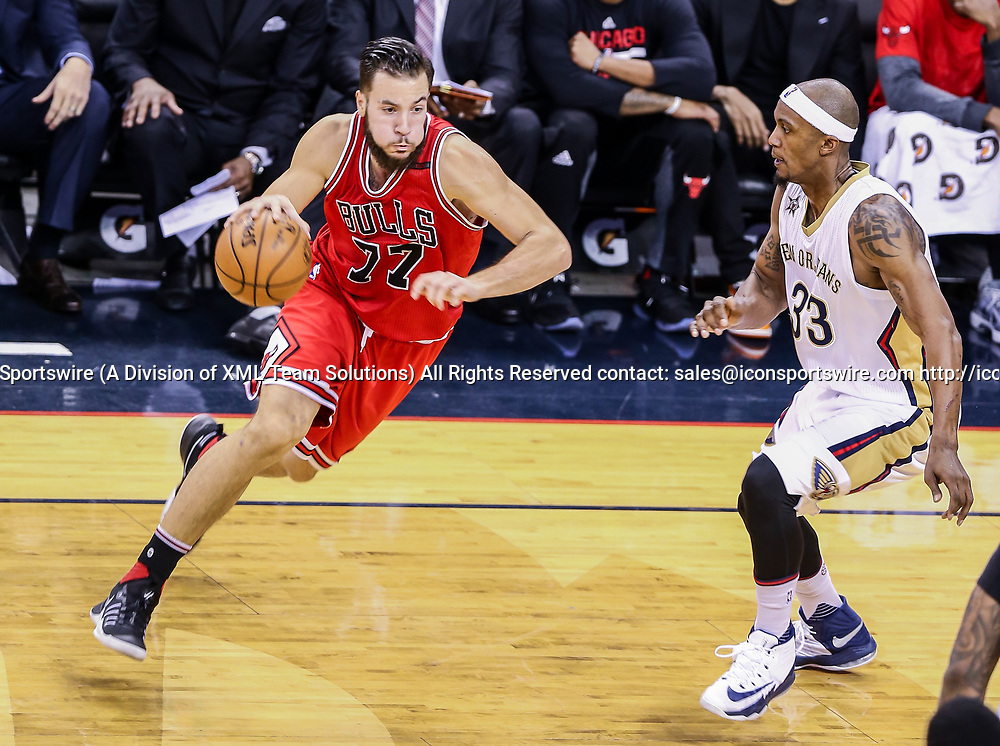 NEW ORLEANS, LA - APRIL 02: Chicago Bulls center Joffrey Lauvergne (77) dribbles against New Orleans Pelicans forward Dante Cunningham (33) during the game between the New Orleans Pelicans and the against the Chicago Bulls on April 2, 2017, at Smoothie King Center in New Orleans, LA.  Bull won 117-110. (Photo by Stephen Lew/Icon Sportswire)