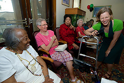 Clowns without Borders visits residents of Wesley Enhanced Living at Stapeley for an afternoon of fun. All participants graduate the 'Clown University' and receive a bright red nose to prove it.