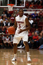 Dec 22, 2011; Stanford CA, USA;  Stanford Cardinal guard Chasson Randle (5) dribbles the ball against the Butler Bulldogs during the first half at Maples Pavilion.  Butler defeated Stanford 71-66. Mandatory Credit: Jason O. Watson-US PRESSWIRE