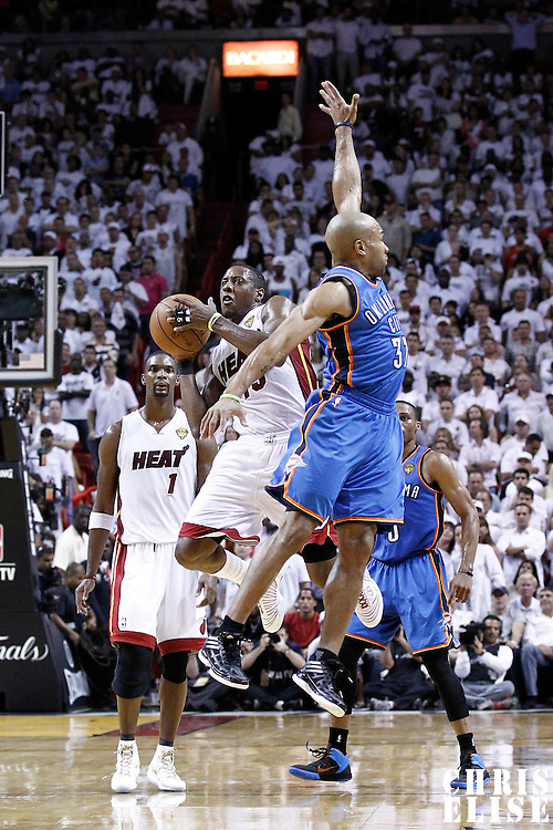 19 June 2012: Miami Heat point guard Mario Chalmers (15) takes a jumpshot at the buzzer at the end of the third quarter of Game 4 of the 2012 NBA Finals, Thunder at Heat, at the AmericanAirlinesArena, Miami, Florida, USA.