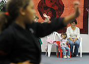 SUN-STAR PHOTO BY BEA AHBECK<br /> 5:43 p.m. Dessira imitates her sister's karate moves while watching the class wth her grandmother Renate at Deziga Shorin Ryu Karate &amp; Kobudo, in Atwater, Calif. Nov. 19, 2010.