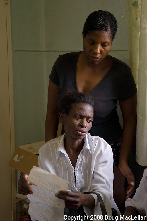 Howard Hospital, Zimbabwe. December 12, 2008. Two women entered Paul Thistle's office where he he issued a death certificate after a short and polite conversation. Thistle is the Chief Medical Officer of the Howard Hopistal in Zimbabwe.