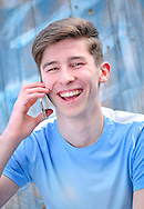 Teenager Using a Mobile Phone - May 2015.