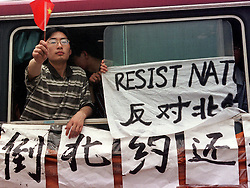 "CHINA SHANGHAI 9MAY99 - Chinese student demonstrators on a bus hold a banner which reads ""Resist NATO"" and fly a miniature Chinese flag in Shanghai May 9. Several thousand protesters gathered on Shanghai's streets today demonstrating against NATO's bombing of the Chinese embassy in Belgrade.    jre/Photo by Jiri Rezac   REUTERS"