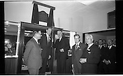 Official Opening of I.C.T.House..1963..01.10.1963..10.01.1963..1st October 1963..Dr James Ryan TD, Minister for Finance,officially opened I.C.T. House ,Adelaide Road, Dublin, for international Computers and Tabulators Ltd. The company had staff working in several sites around the city and the new premises will bring all of them together under the one roof...Picture shows Dr Ryan (third right) unveiling a plaque in the hall commemorating the opening of I C T House..From left, Mr E H White, Overseas Sales Manager,ICT; Mr John Bull, Managing Director, ICT London; Dr Ryan; Mr O P Mullett, General Manager, ICT Ireland