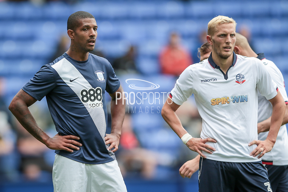 Dean Moxey (Bolton Wanderers) and Jermaine Beckford (Preston North End) wait for a corner to be played in during the Pre-Season Friendly match between Bolton Wanderers and Preston North End at the Macron Stadium, Bolton, England on 30 July 2016. Photo by Mark P Doherty.