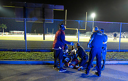 August 18, 2018 - Wellington, Florida, U.S. - A police officer applies pressure to the wound of a gunshot victim. Two adults were shot Friday night at a football game between Palm Beach Central and William T. Dwyer high schools, authorities said. The gunfire sent players and fans screaming and stampeding in panic during the fourth quarter of the game at Palm Beach Central High School in Wellington, Florida on August 17, 2018. (Credit Image: © Allen Eyestone/The Palm Beach Post via ZUMA Wire)