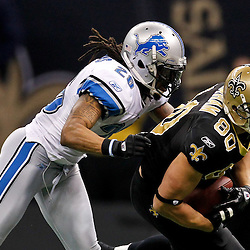 January 7, 2012; New Orleans, LA, USA; New Orleans Saints tight end Jimmy Graham (80) is tackled by Detroit Lions safety Louis Delmas (26) during the 2011 NFC wild card playoff game at the Mercedes-Benz Superdome. Mandatory Credit: Derick E. Hingle-US PRESSWIRE