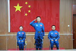 59797601<br /> The three astronauts of the Shenzhou-10 manned spacecraft mission, Nie Haisheng (C), Zhang Xiaoguang (R) and Wang Yaping, meet the media at the Jiuquan Satellite Launch Center in Jiuquan, northwest China s Gansu Province, June 10, 2013. The Shenzhou-10 manned spacecraft will be launched at the Jiuquan Satellite Launch Center at 5:38 p.m. Beijing Time (0938 GMT) June 11.<br /> UK ONLY