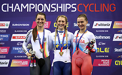 Great Britain's Laura Kenny (centre) with her gold medal for the women's elimination race alongside silver medallist Germany's Anna Knauer (left) and bronze medallist Russia's Evgeniya Romanyuta during day four of the 2018 European Championships at the Sir Chris Hoy Velodrome, Glasgow.