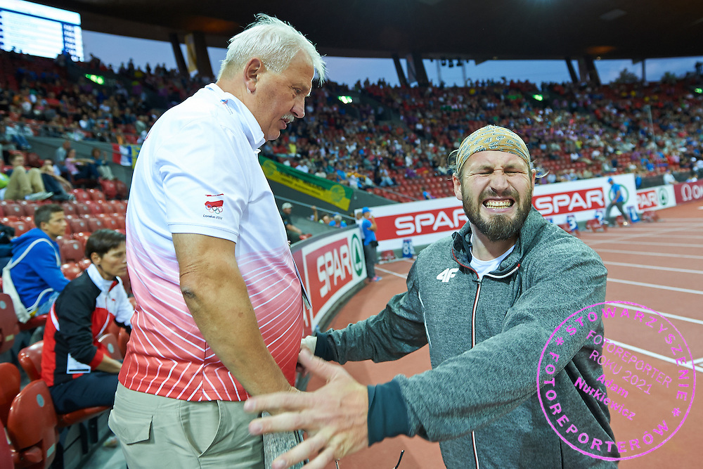 (R) Tomasz Majewski of Poland reacts after his attempt and (L) Henryk Olszewski trainer coach of Tomasz Majewski of Poland while men's shot put final during the First Day of the European Athletics Championships Zurich 2014 at Letzigrund Stadium in Zurich, Switzerland.<br /> <br /> Switzerland, Zurich, August 12, 2014<br /> <br /> Picture also available in RAW (NEF) or TIFF format on special request.<br /> <br /> For editorial use only. Any commercial or promotional use requires permission.<br /> <br /> Photo by &copy; Adam Nurkiewicz / Mediasport