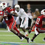 Louisville Cardinals quarterback Teddy Bridgewater (5) scrambles during the NCAA Football Russell Athletic Bowl football game between the Louisville Cardinals and the Miami Hurricanes, at the Florida Citrus Bowl on Saturday, December 28, 2013 in Orlando, Florida. Louisville won the game by a score of 36-9. (AP Photo/Alex Menendez)