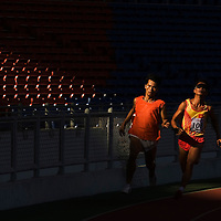 Athlete from Vietnam, Lee Hung Duc (R) runs with his sighted guide during the mens final events at 5th ASEAN Para Games in Kuala Lumpur, Malaysia 16 August 2009.