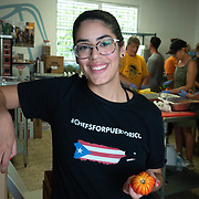 JULY 20, 2018---HATO REY, PUERTO RICO----<br /> Volunteer Camille Mercado Rivera, 19, in the kitchen of Chefs for Puerto Rico as food is prepared to be delivered during the day as part of the World Central Kitchen initiative in Puerto Rico which came to prominence following the aftermath of the devastation left by Hurricane Maria in Puerto Rico. <br /> (Photo by Angel Valentin/Freelance)